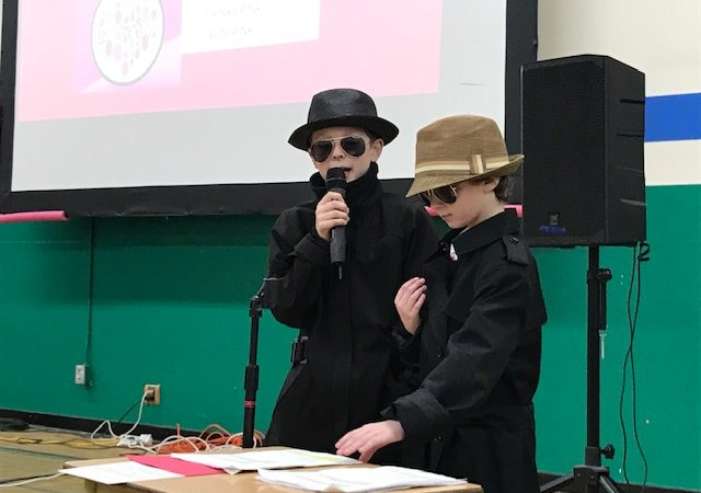 Kindness Detectives Report Results of Sleuthing at February Assembly!